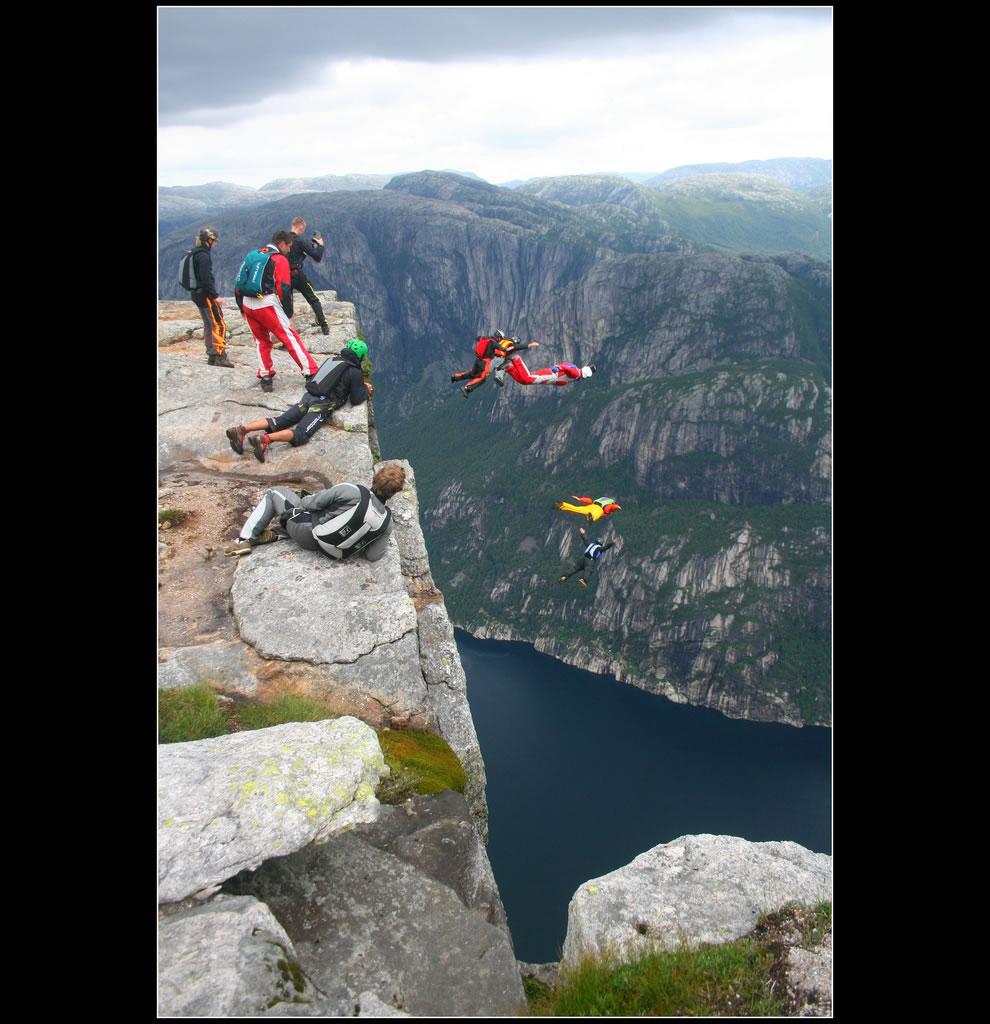 Kjerag cliff in Norway - basejumpers