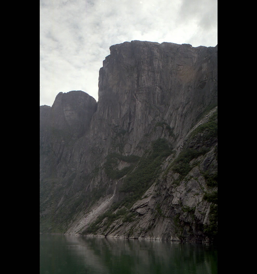 Looking up at Kjerag - famous cliff in Norway