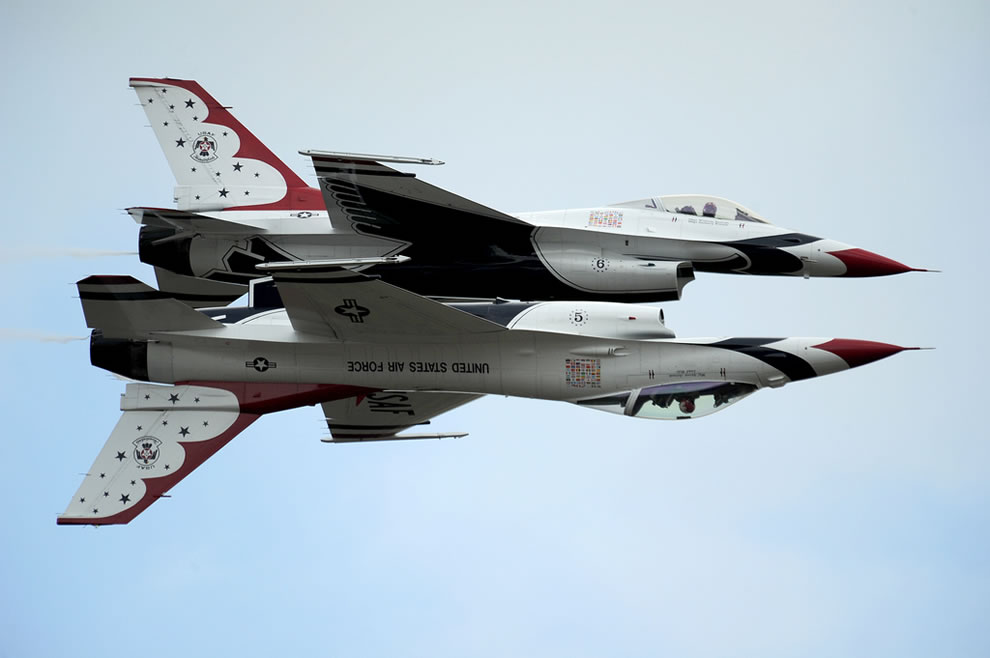 Thunderbird 5, Lead Solo and Maj. J.R. Williams, Thunderbird 6, Opposing Solo, perform their signature maneuver, the Reflection Pass
