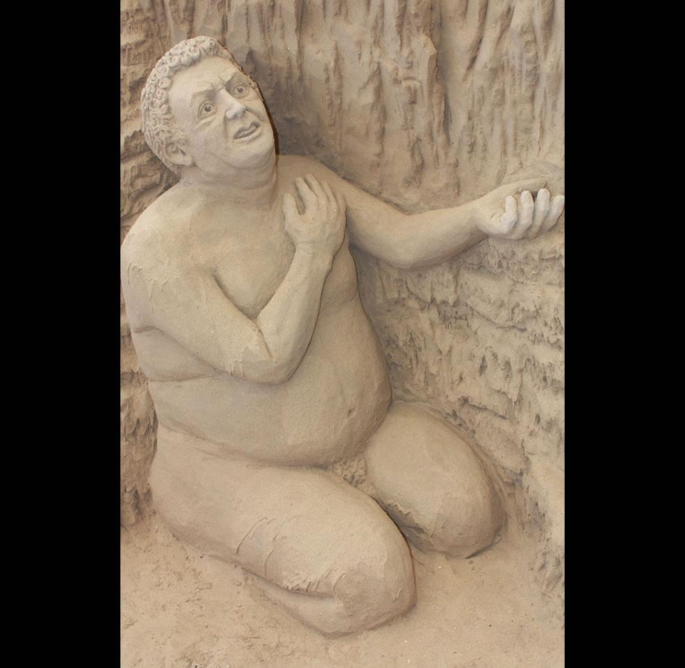 Circle 3 The Gluttons sand sculpture in Dante's Inferno, Jesolo Lido