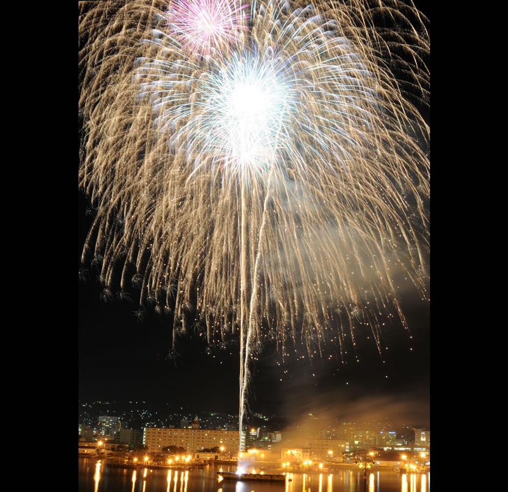 Fireworks explode over Navy Fleet Activities in Japan