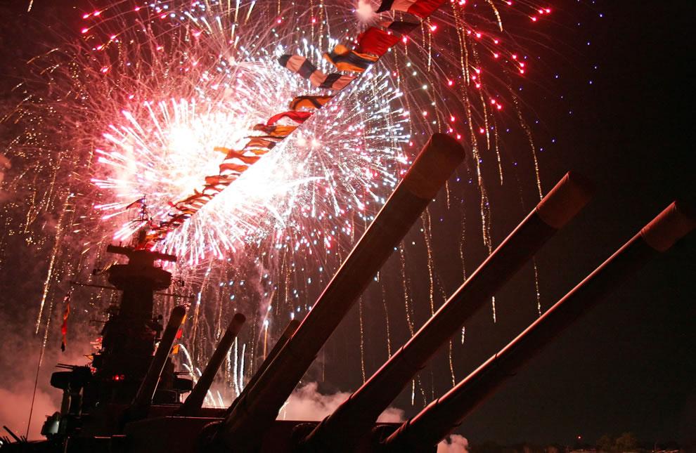 Fireworks illuminate the skies over Battleship North Carolina - newest Virginia-class nuclear attack submarine USS North Carolina
