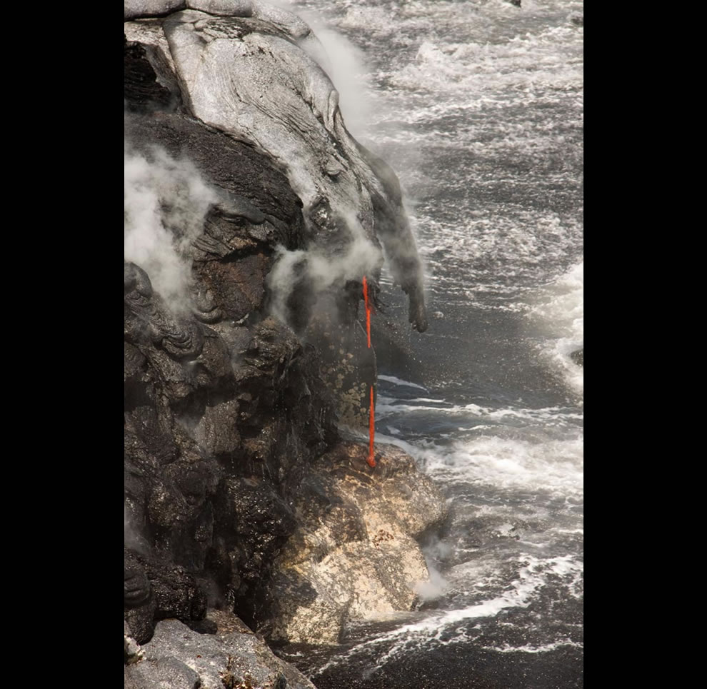 lava streaming into ocean at Hawaii National Park