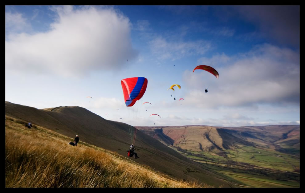 Paragliders launching off Mam Tor in the UK Peak District