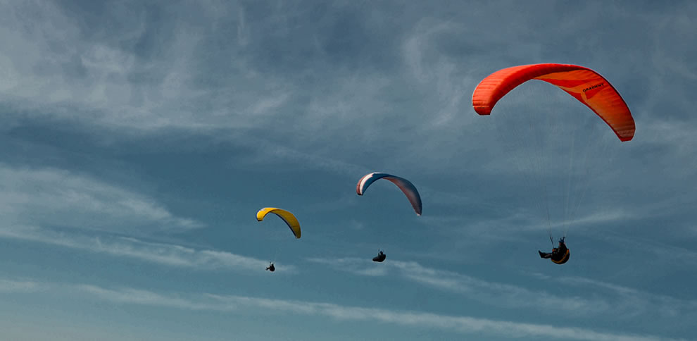 Trio of paragliders