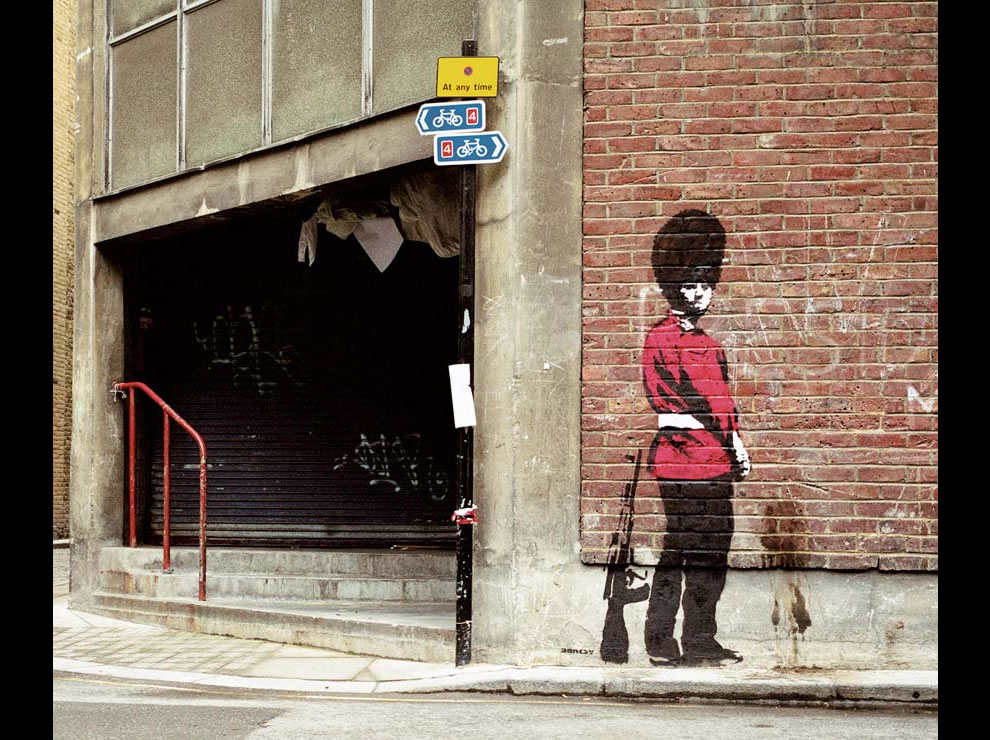 guard peeing Banksy