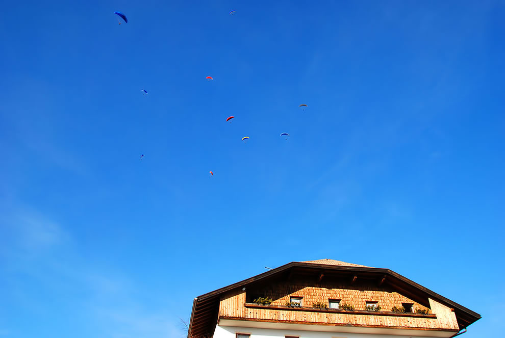 thermal up wind flock of paragliders, Luson, Trentino-Alto Adige, Italy