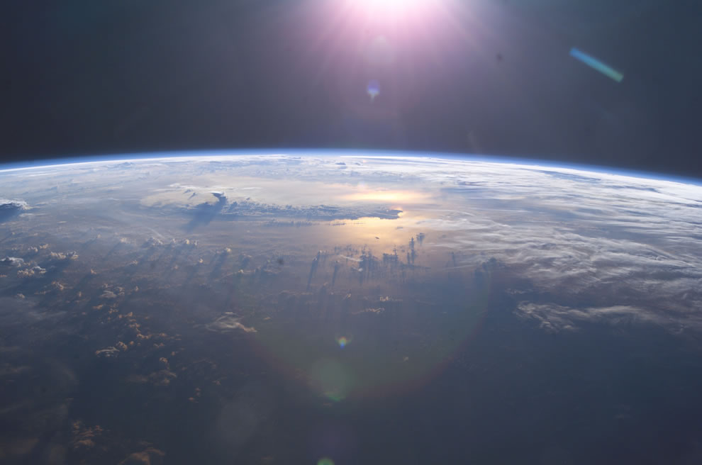 ISS View of Earth's horizon as the sun sets over the Pacific Ocean