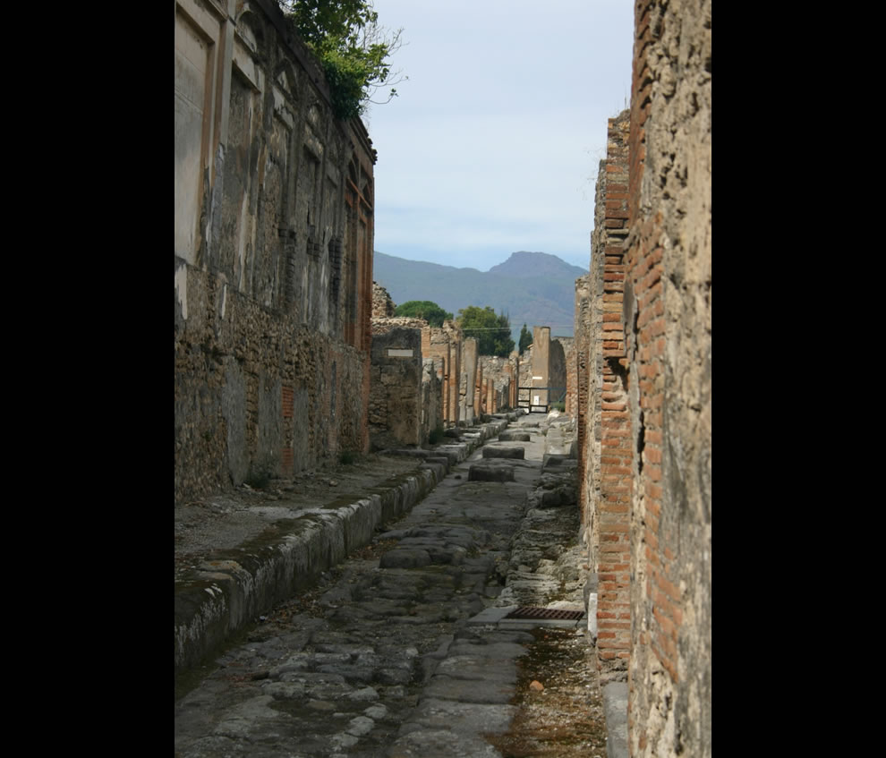 Street in Pompeii, Italy - Vesuvius in background