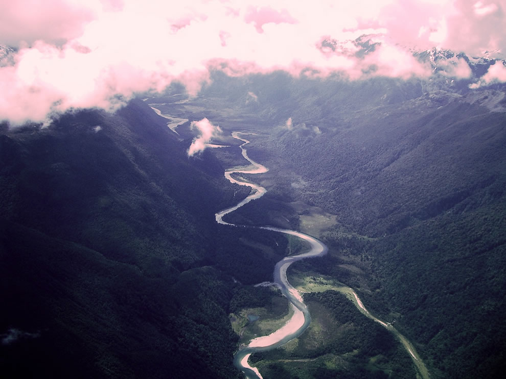 River Run - Aerial photo of a river around milford sound, New Zealand, south island