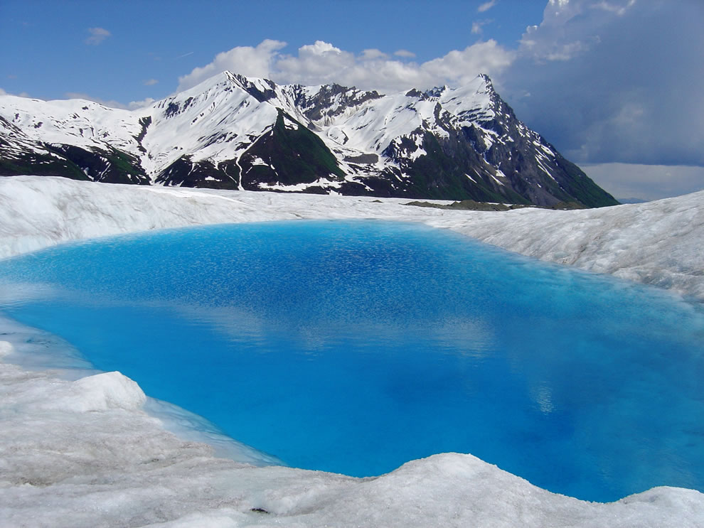 blue glacial pool can be found at Wrangell -- St. Elias National Park and Preserve, Alaska