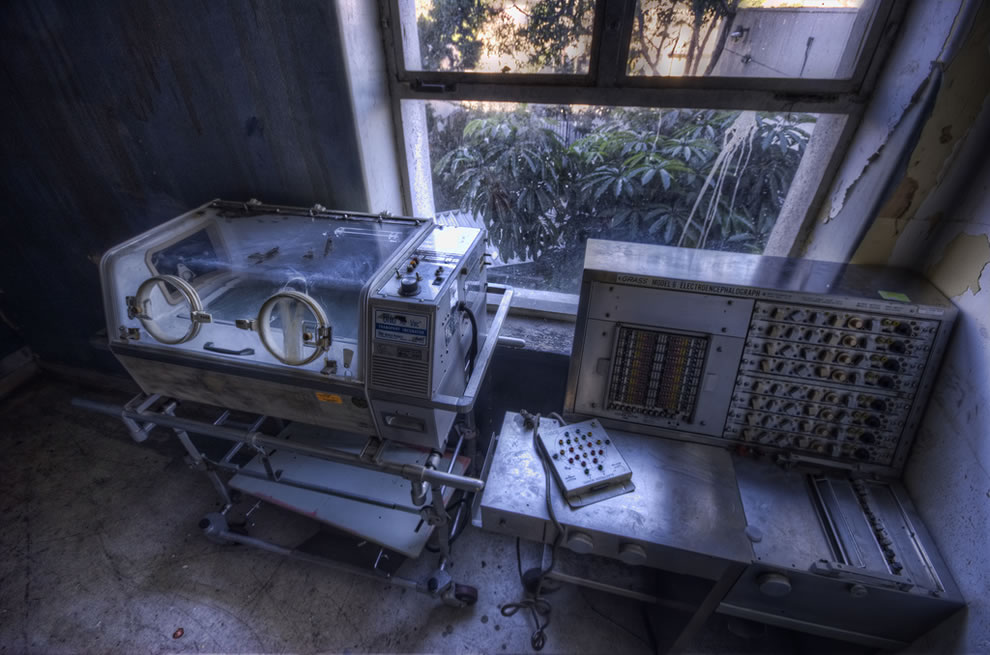 An EKG machine and an incubator from a company named 'GRASS' at abandoned, haunted Linda Vista