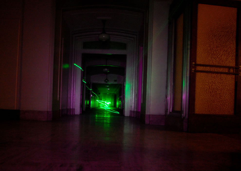 Experimenting with a green laser during this paranormal investigation at Linda Vista Community Hospital