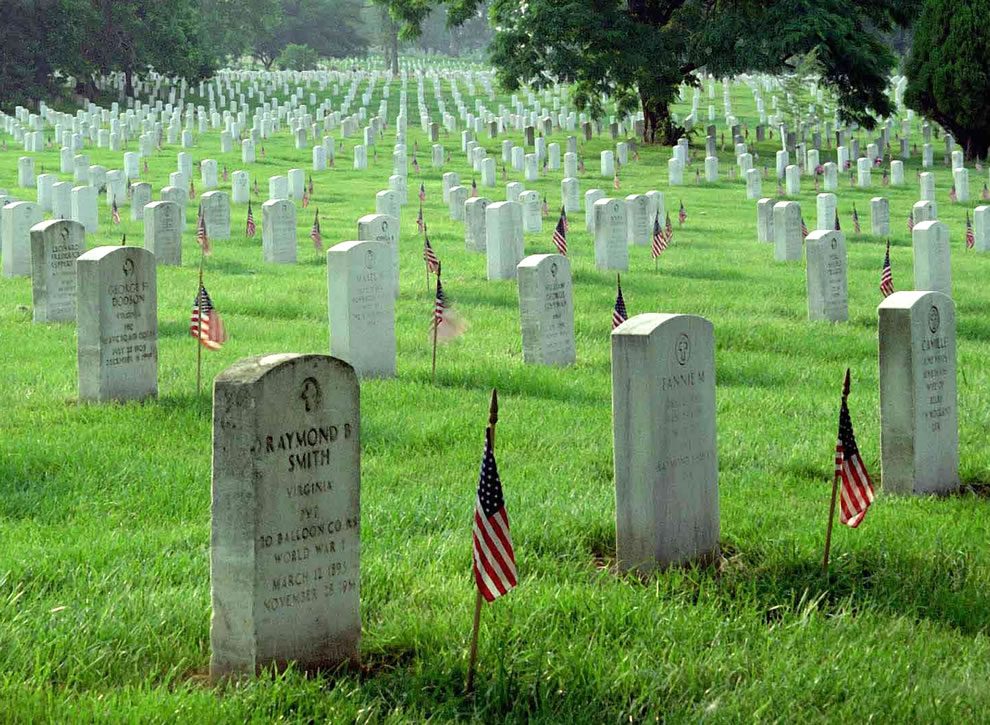 Gravestones at Arlington National Cemetery are decorated by U.S. flags on Memorial Day weekend