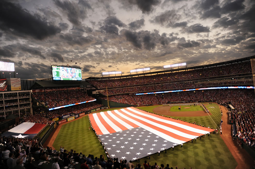 U.S. Service members with the Texas Military Forces participate in Game 3 of the Major League Baseball World Series in Arlington, Texas