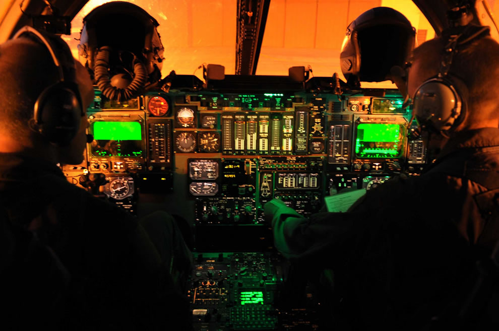 Pilots conduct preflight checklists in the cockpit of a B-1B Lancer aircraft