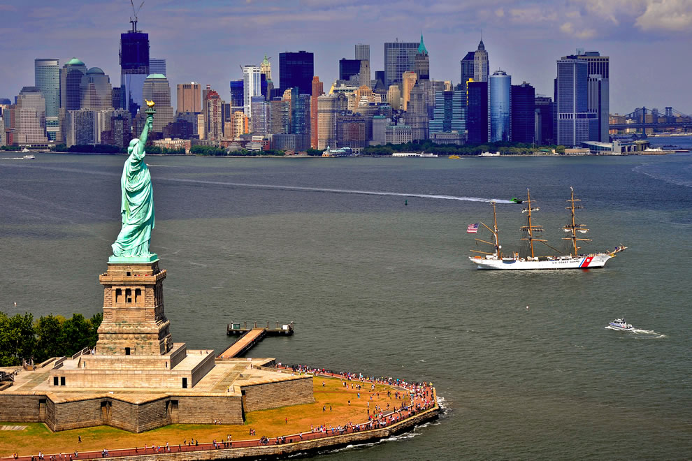 The Coast Guard Cutter Eagle sails toward New York Harbor to anchor at the Statue of Liberty