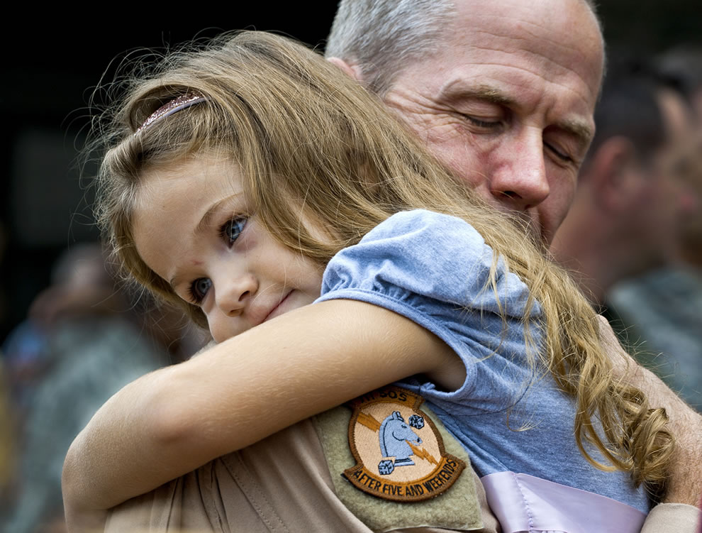 U.S. Air Force Lt. Col. Thomas Frazier of the 711th Special Operations Squadron receives an overdue hug from his daughter after returning from a deployment to Southwest Asia