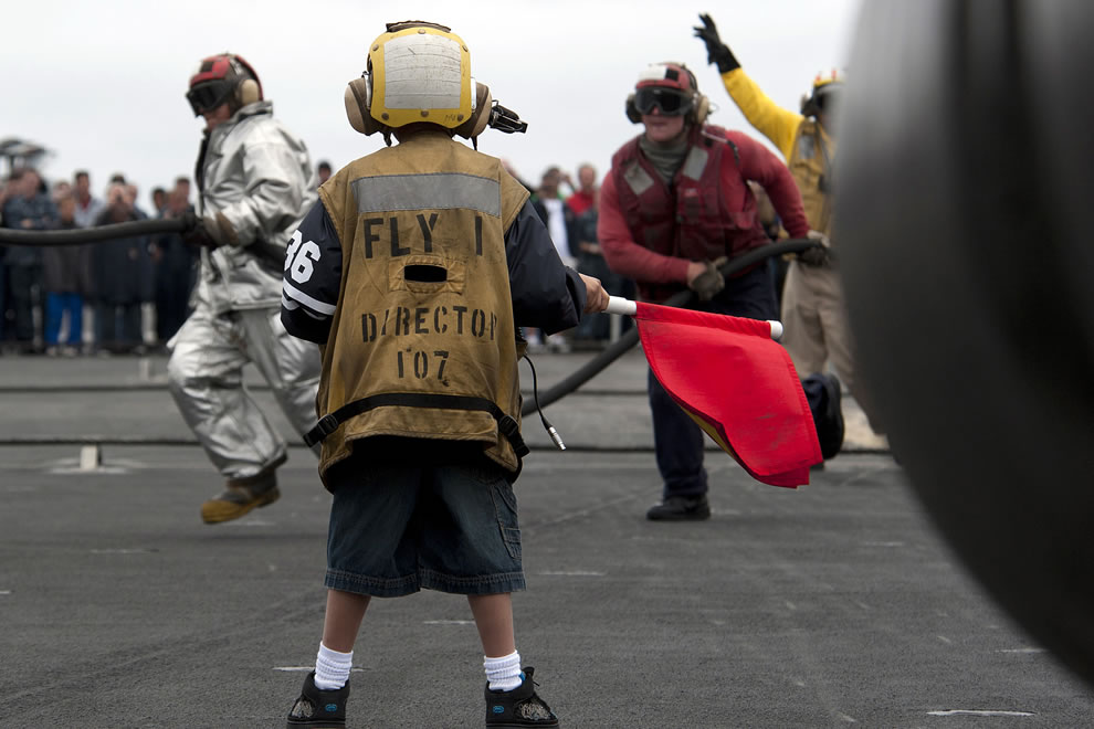 Navy flight deck personnel with little helper -- military appreciation