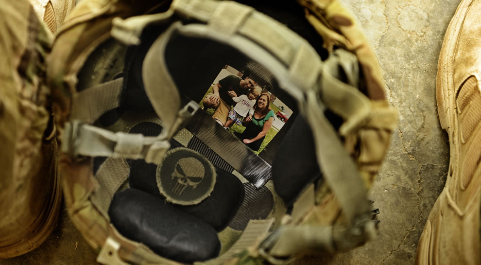 Picture of his family in his helmet while out on a combat patrol