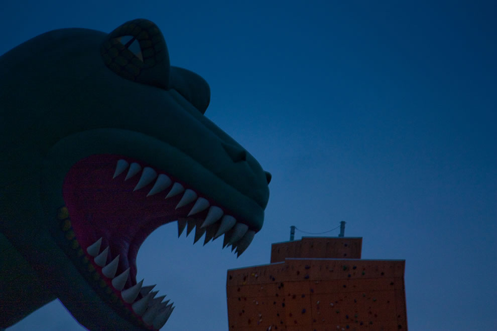 Dinosaur about to chomp on Excalibur tower