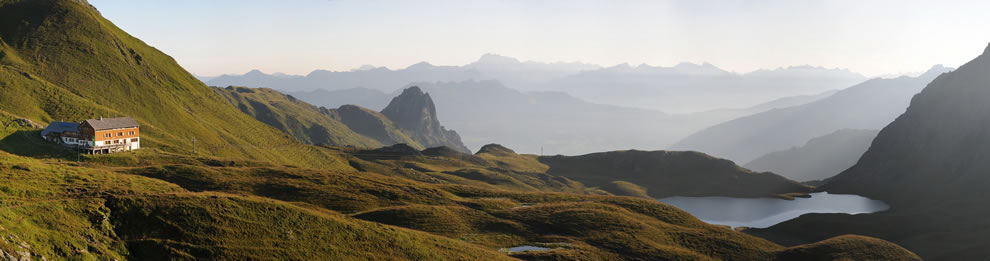 Panoramic picture of Rätikon mountain range in Austria, near the border of Switzerland, with Austrian Alpine Club hut Tilisunahütte on the left