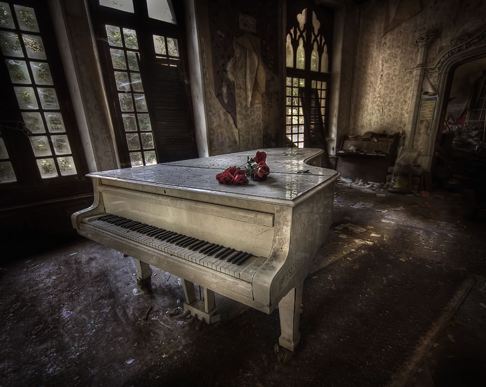 Great white piano in abandoned manor house