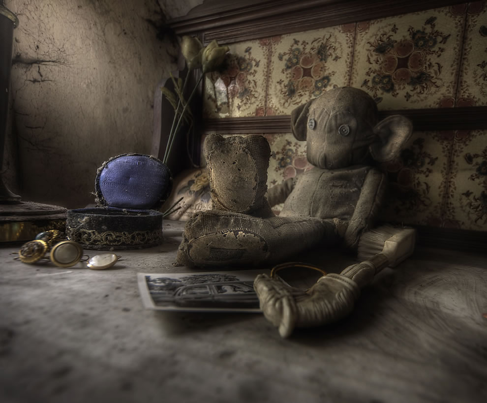 Rooms full of old toys and decay at abandoned manor house