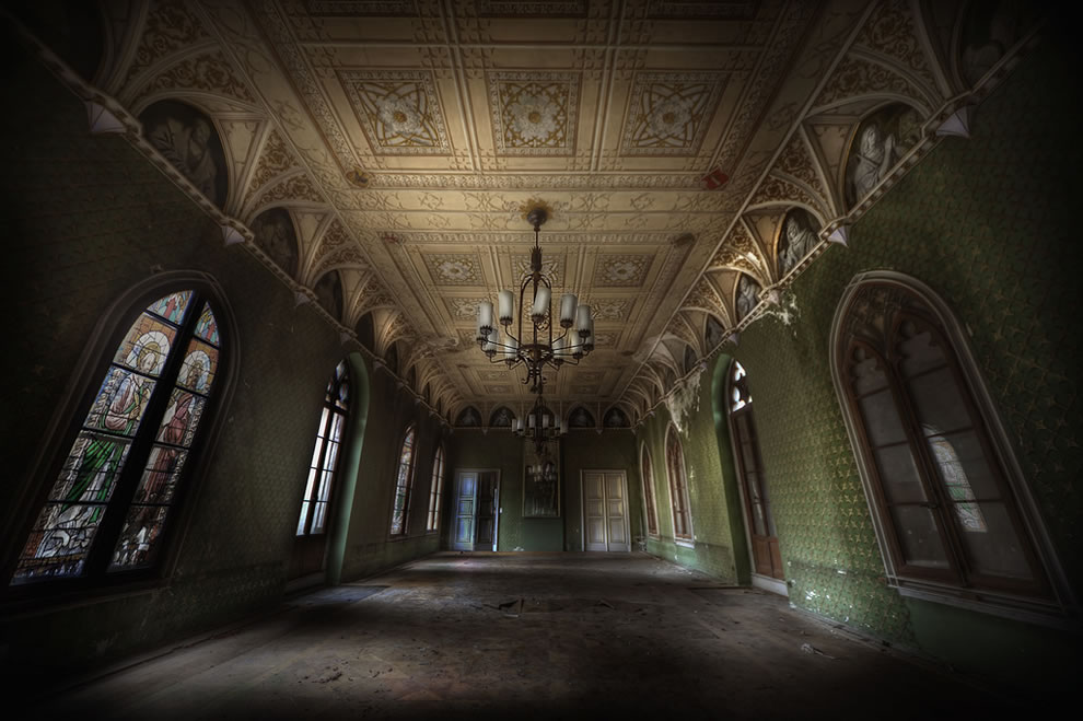 This abandoned grand ballroom was one of the best I have seen, real heavy decay creeping in from all over, was once a hotel too
