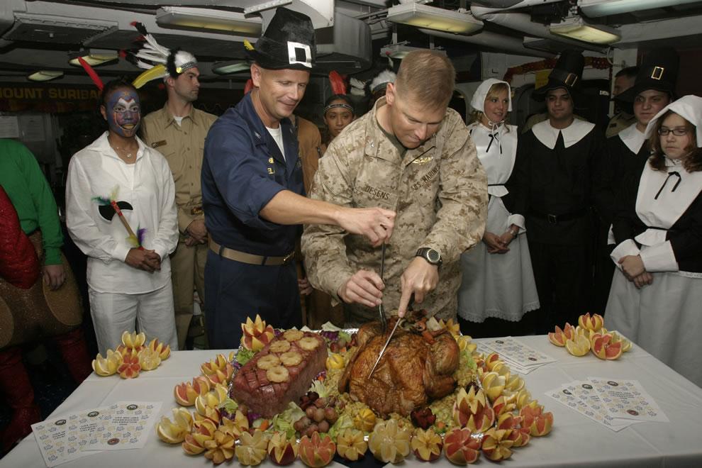 Captain Robert Irelan and Colonel Mark J. Desens carve the Thanksgiving turkey aboard USS Iwo Jima