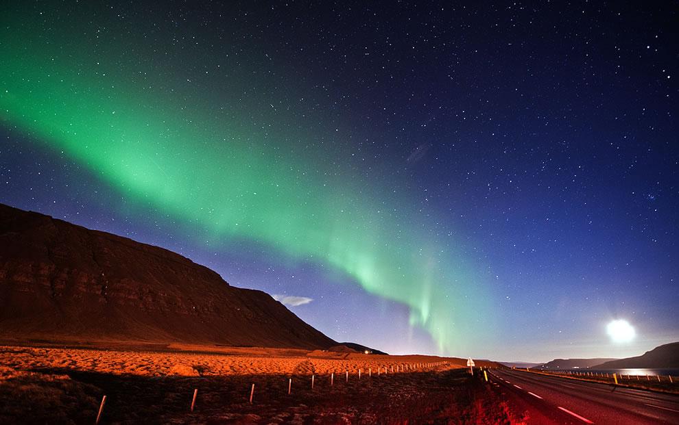 Moon rising and green aurora