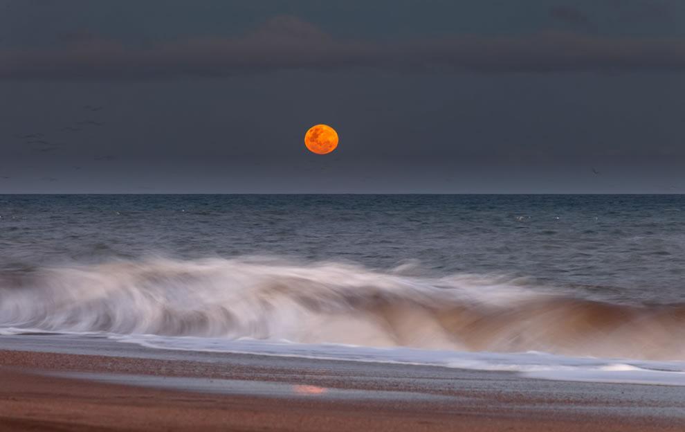 Moonrise Behind the Waves