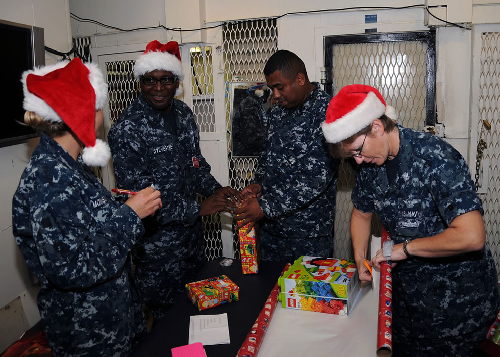 Navy wrap donated gifts for U.S. Sailors and their families at Polaris Point, Guam