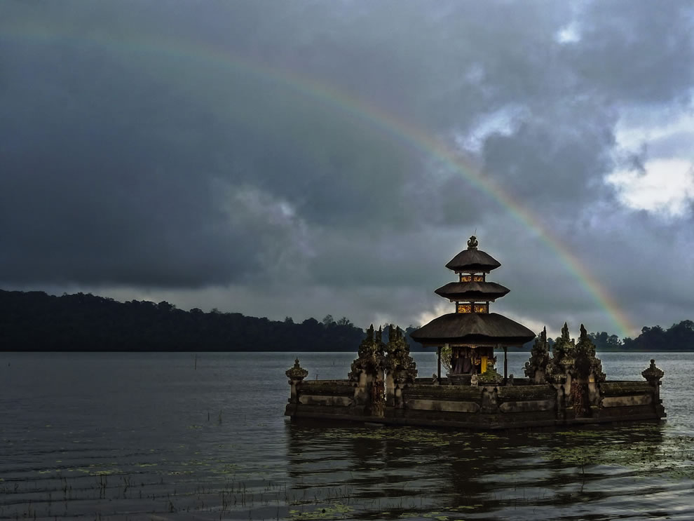 Rainbow over Bali temple for the sea goddess