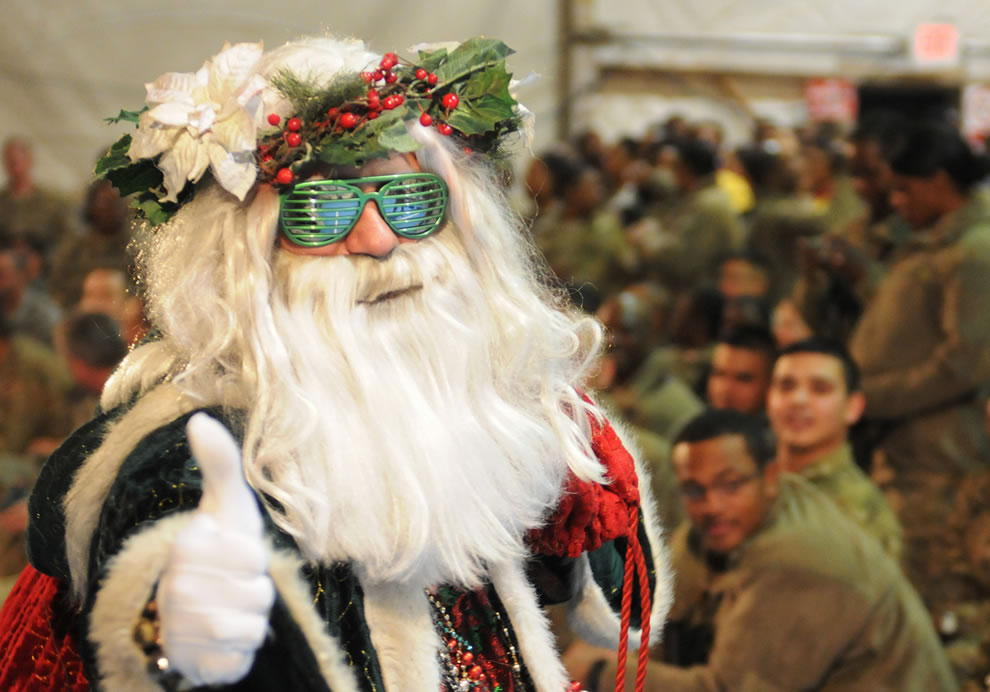 Santa gives a thumbs-up during the USO Holiday Troop Visit to Bagram Airfield, Afghanistan