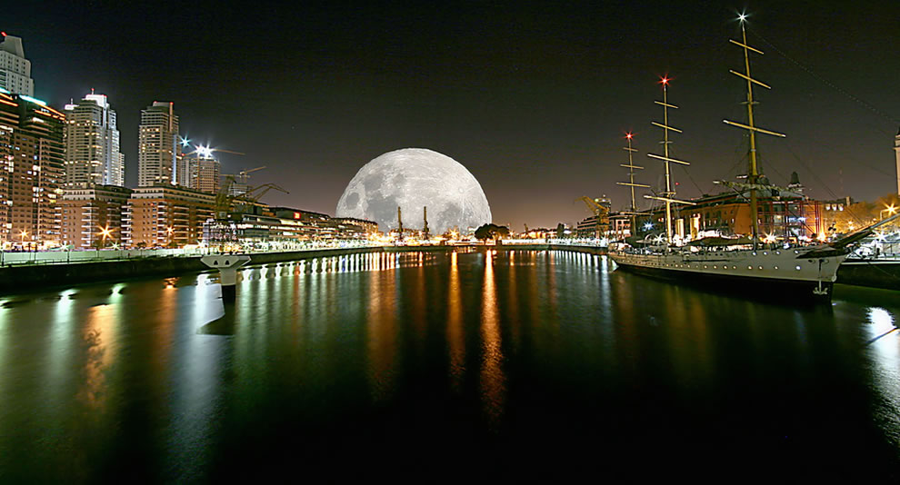 The full moon and a night view of Puerto Madero