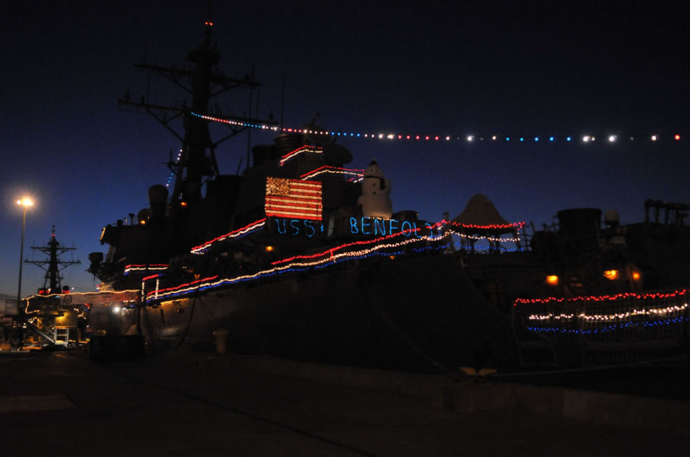 The guided-missile destroyer USS Benfold displays its holiday lights
