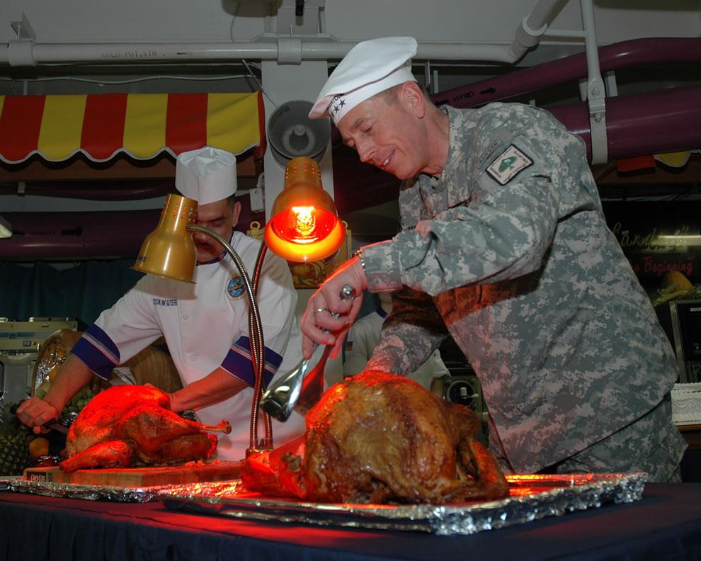 U.S. Army Gen. David H. Petraeus, commander of U.S. Central Command, carves a turkey