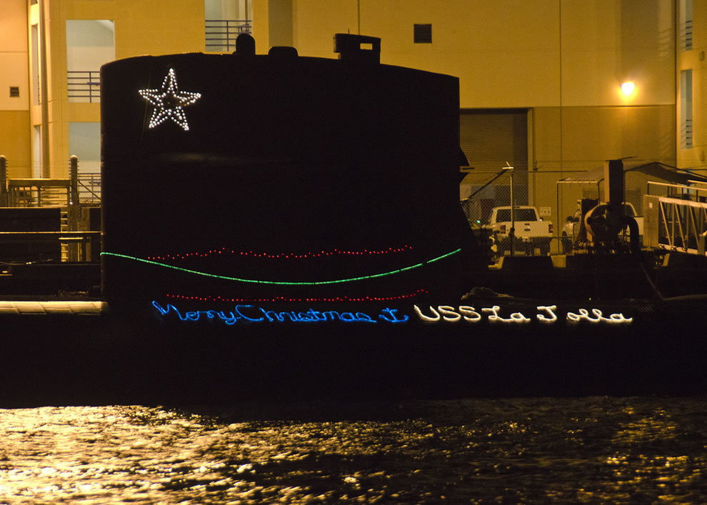 U.S. Navy ships and submarines moored in Pearl Harbor participating in the holiday season by decorating with lights in what has become an annual tradition