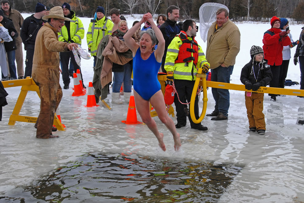 Bravely scream like nobody is watching while taking the polar bear plunge at Empire Winter Fest & Polar Bear Dip