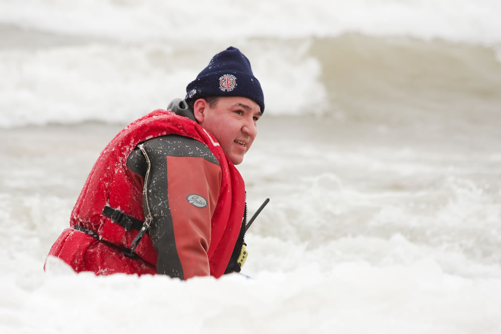 Milwaukee Fire Department worker wears a drysuit in the water during a polar bear plunge watching for swimmers that may need assistance