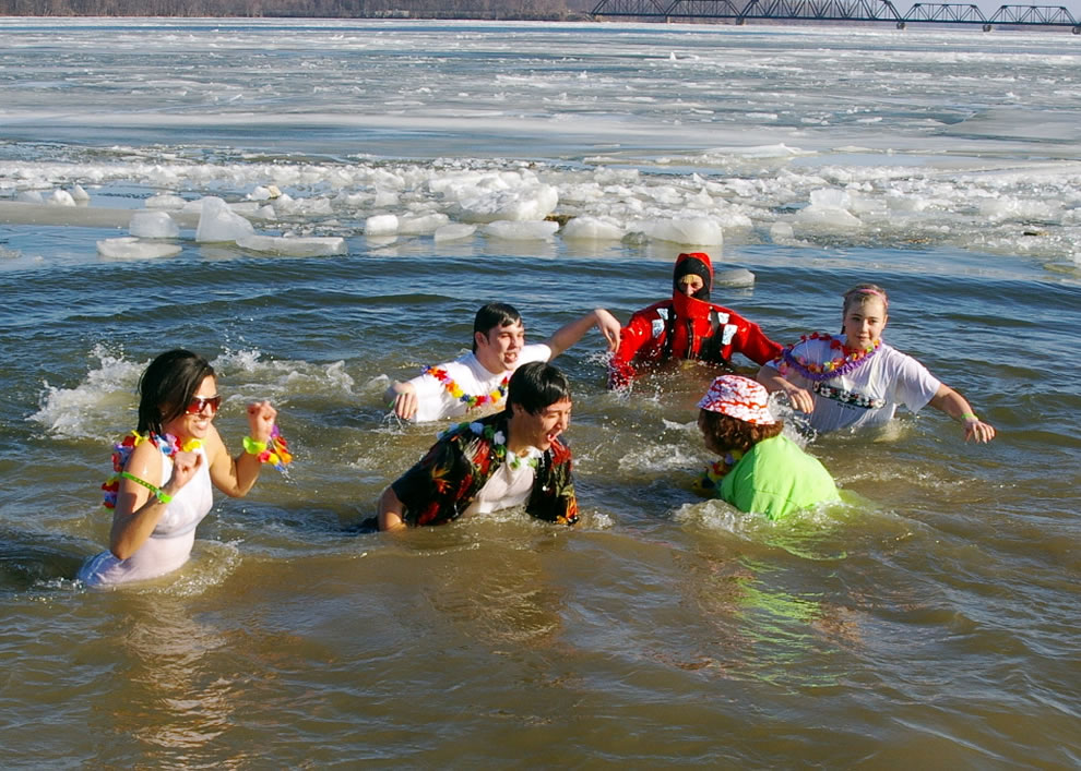 Polar Bear plunge, brave folks were dressed for a beach in Hawaii but instead found themselves in the frigid waters of the Mississippi for a good cause