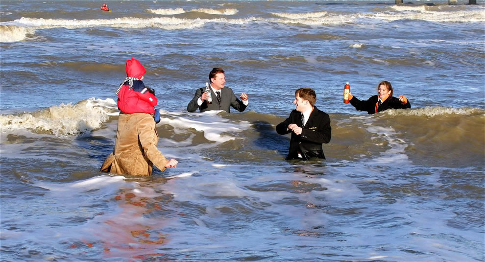 Polar Bear swim at The Hague. Traditionally, a few members of the Hague Sudenten Association dress up in nice suits, take to the icy sea, and toast to good New Year's wishes