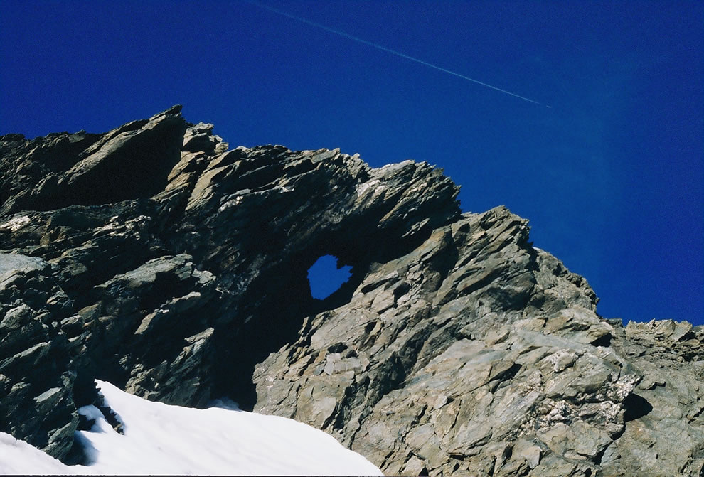 Heart in rock of Écrins mountain, French Alps