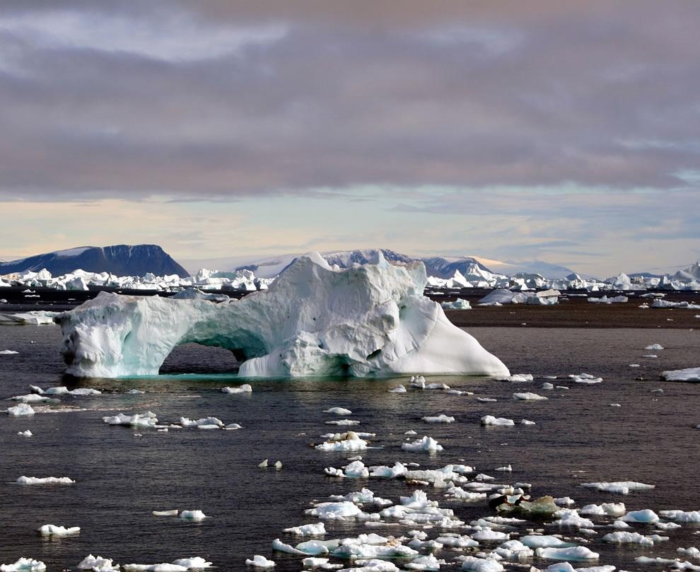 Iceberg with hole, Icebergs around Cape York, Greenland