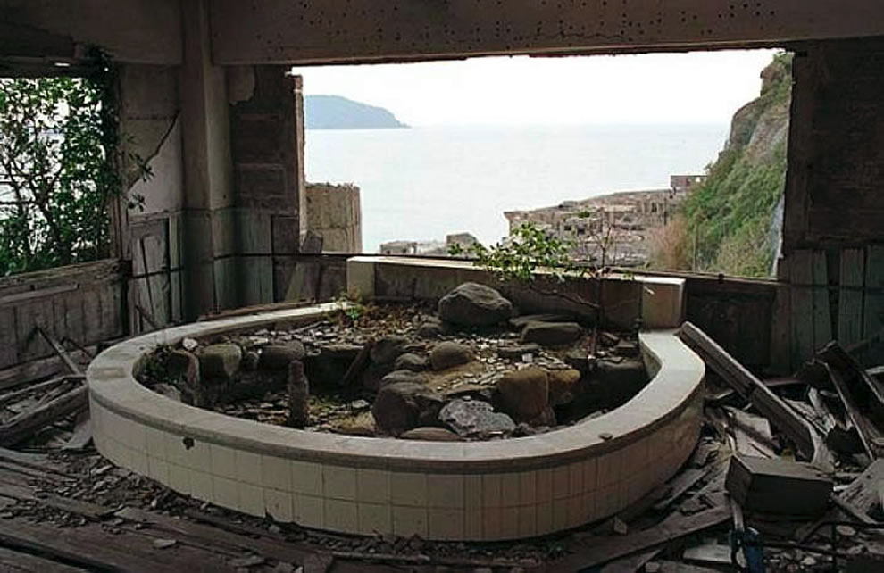 Nature reclaiming a room with a view at Battleship Island, aka No Man's Land, Gunkanjima, Ghost Island