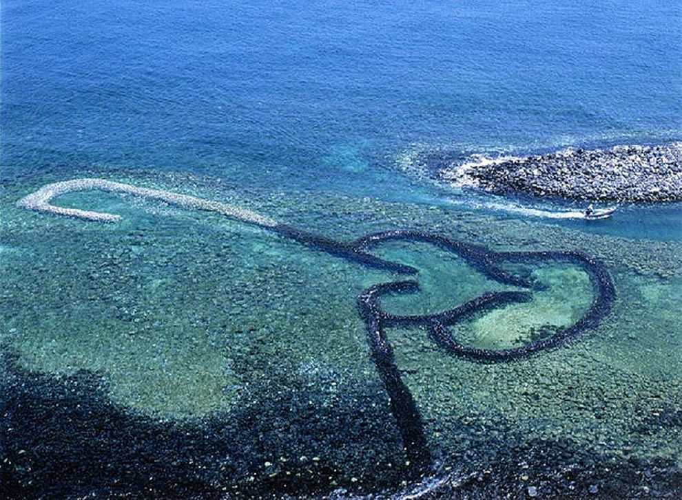 Sea rocks form double heart, twin hearts stone weir in Penghu,Taiwan