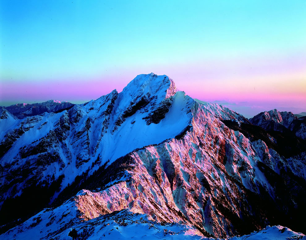 Sunrise over Yushan, In the winter, Yushan is often capped with thick snow which makes the entire peak shine like stainless jade which is where it got the name Jade Mountain