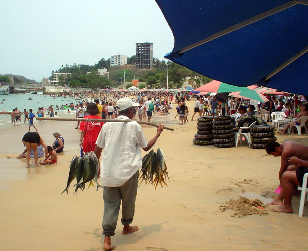 Vendor with fish at Playa Caleta