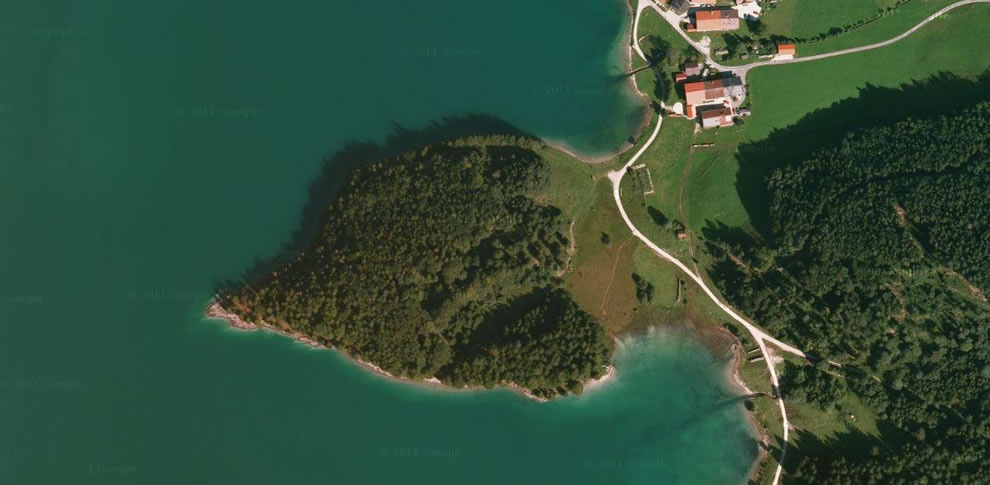 Aerial view of heart-shaped forested island in Walchensee Germany